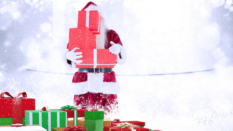 Santa clause holding christmas presents combined with falling snow Animation