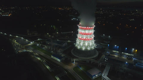 aerial motion to cooling tower in carcass with projectors Footage