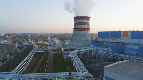upper view heating station with buildings and cooling tower Footage