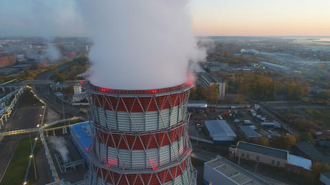 aerial motion around white steam pillar above cooling tower GIF