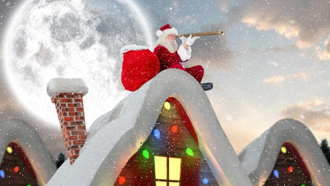Santa clause on a roof in winter scenery combined with falling snow Live Action