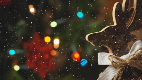 Falling snow with Christmas raindeer decoration Animation