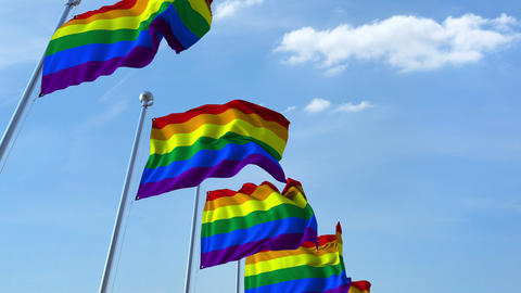Waving LGBT pride flags against the sky Footage