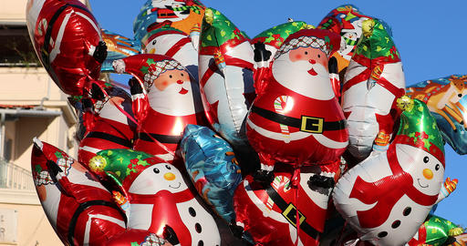Helium Christmas Balloons Of Different Shapes And Characters Floating In The GIF
