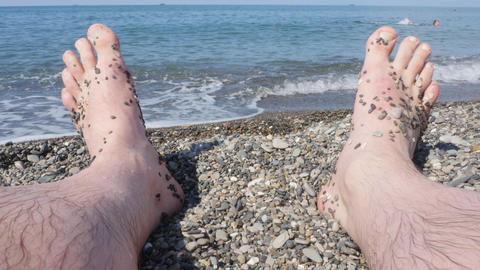 Feet against the sea on a summer day Live Action