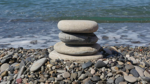 Build a pyramid of stones on the beach Footage