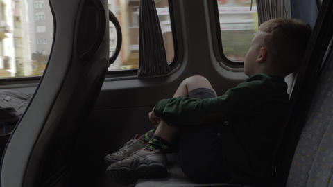 Child looking out the window during car journey Footage
