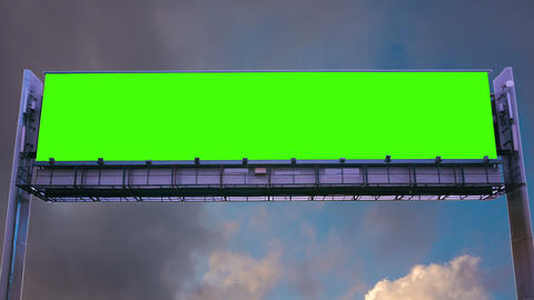 Billboard green screen on the background of flying clouds Footage