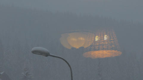 Snowfall on the mountains - reflection of lamp on the window ビデオ