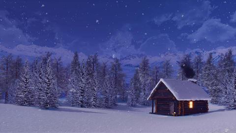 Snow covered mountain hut at snowfall winter night ビデオ