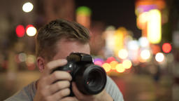 Face of young tourist man photographing against view of the streets in Chinatown 영상물