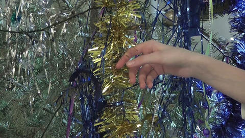 Girl touch Christmas decoration, only hands ビデオ