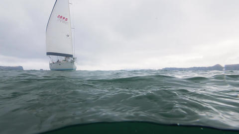 Sea yacht sailing in sea underwater view. Sea level view, scuba diving shooting Live Action