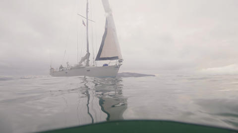 Sail yacht sailing in sea waterline view. Underwater view sailing yacht in ocean Live Action