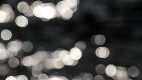 Abstract nature. Bokeh sun glare glistening on water surface GIF