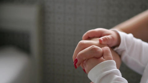 Concept of love and family. hands of mother and baby... Stock Video Footage