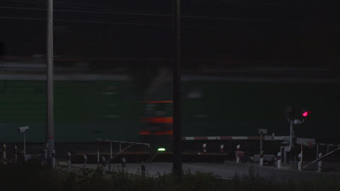 Flashing red traffic light at a railway crossing at night on background of a ビデオ