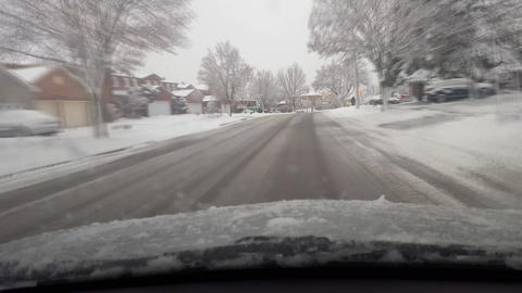 Driving up to Snowy Surburb Intersection in North America With Motion Blur Footage