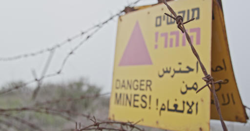 Minefield warning sign in the Golan Heights in the Syria Israel border Footage