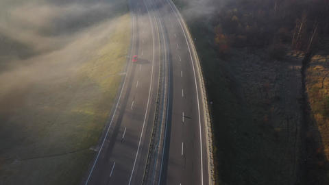 View from the height of the road on which cars are moving. The road is shrouded Footage