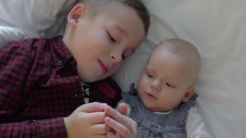 Loving and careful brother with baby sister Footage
