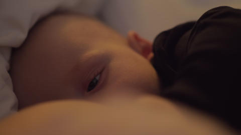 A cute closeup of a breastfeeding scene Live Action