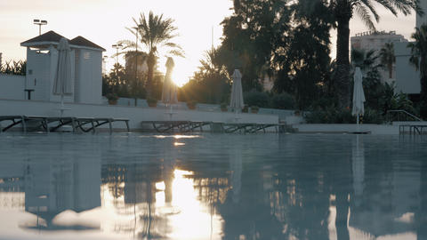 Hotel swimming pool by the sunset GIF