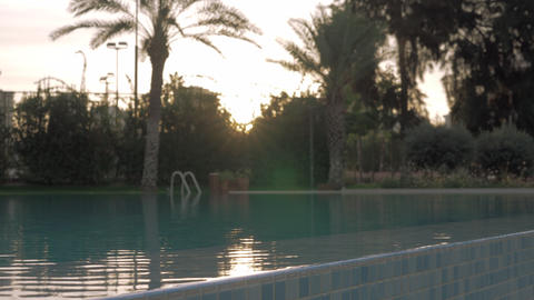 Outdoor swimming pool at sunset Footage