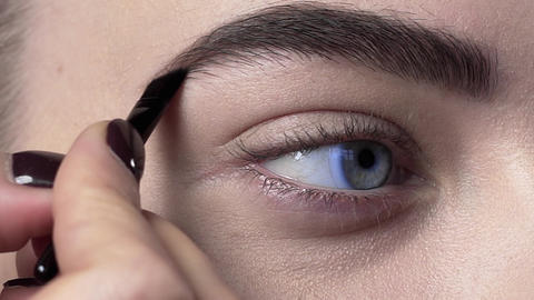 Close up of the eye brows makeup, woman paints brows, eye makeup, beauty fashion Footage