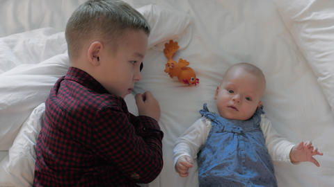 Brother playing with baby sister at home Footage