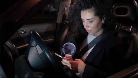 Girl touches holographic navigation touch screen of mobile phone while sitting Live Action