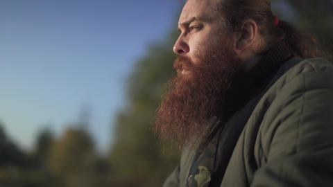 Bearded man smoking a cigarette close-up. A man with a beard smoking a cigarette Footage