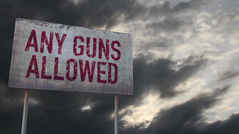 4K Any Guns Allowed Control Rusty Sign under Clouds Timelapse Animation