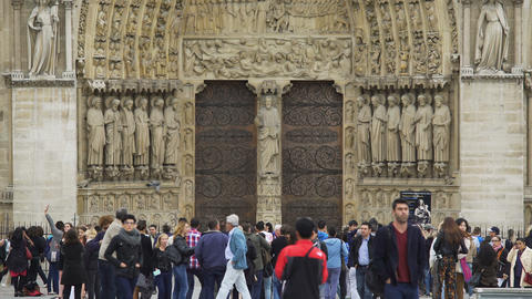 Group of tourists walking near Notre Dame de Paris, sightseeing in France Footage