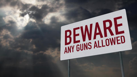 4K Beware Any Guns Allowed Warning Sign under Clouds Timelapse Animation