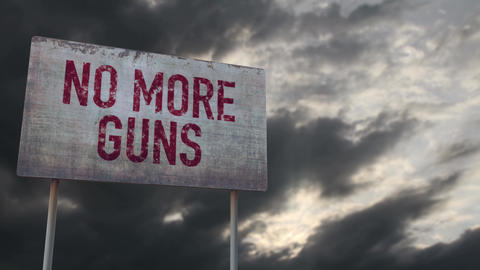 4K No More Guns Rusty Sign under Clouds Timelapse Animation