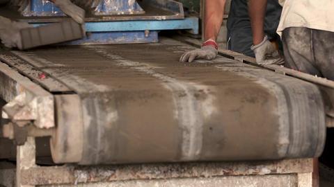 Closeup shot of worker unloads bricks Footage