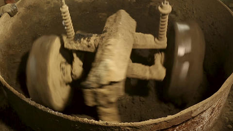 Cement or mortar is inside cement mixer. Cement or mortar is mix Live Action