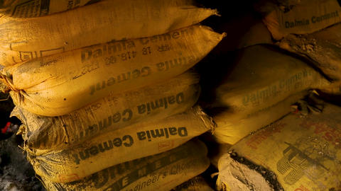 Storage of Cement,Cement bags stacked in a warehousing in India Live Action