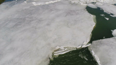cracked ice floating on river at spring, aerial Footage