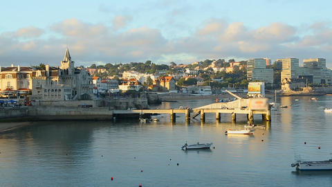 Coastal city lying at harbor with moored sailing boats, tourism Cascais Portugal Footage