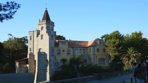 Castle-like house with tower in afternoon sunlight, famous architecture, tourism Footage