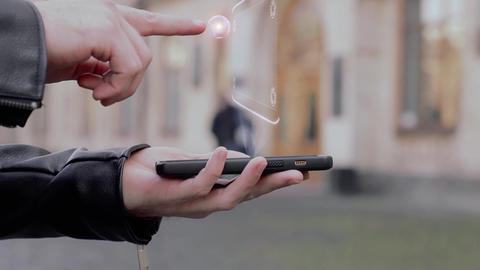 Male hands show on smartphone conceptual HUD hologram eyeglasses Footage
