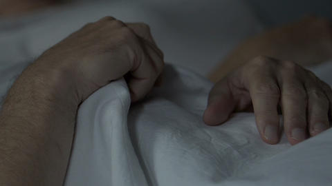 Elderly married couple peacefully sleeping on their new orthopedic bed, comfort Footage
