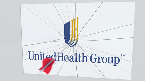 UNITEDHEALTH GROUP company logo being hit by archery arrow. Business crisis Live Action