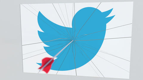 TWITTER company logo being hit by archery arrow. Business crisis conceptual Footage
