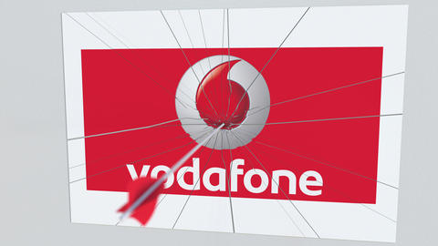 VODAFONE company logo being hit by archery arrow. Business crisis conceptual Live Action