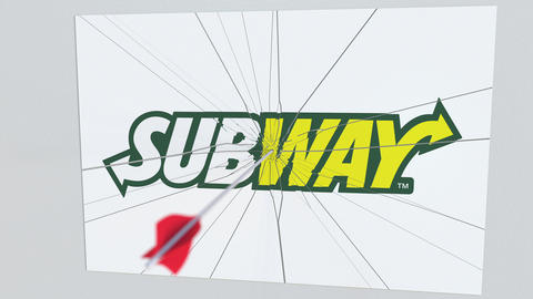 Archery arrow hits plate with SUBWAY logo. Corporate problems conceptual Live Action