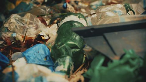 Closeup of waste plastic, consumerism issue on planet, garbage disposal crisis Footage