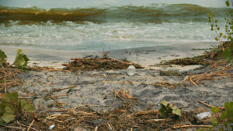 Seashore suffering from water pollution, toxic rubbish degrading soil quality Live Action
